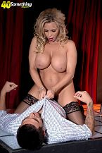 Busty M.I.L.F. lap dancer Amber Lynn suggests extras